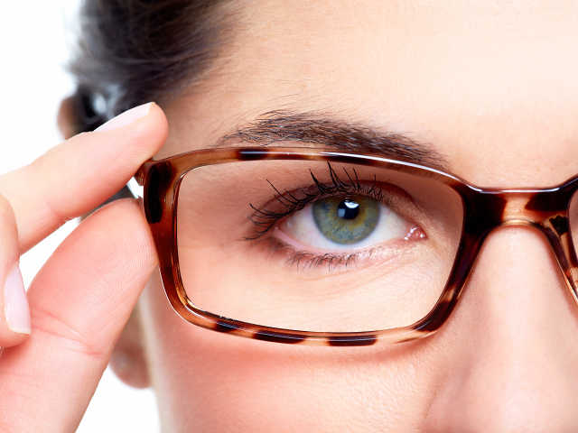 vision centers-woman wearing eyeglasses-optometrist